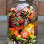 Reuse a large glass food jar and keep it on the countertop for scrap collection. The lid keeps the smell at bay and having the jar near the cutting board makes it easy to chop scraps into small pieces before placing inside, which helps with faster composting.