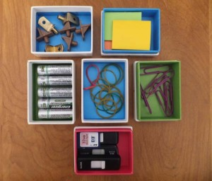 creatively reuse small gift boxes for office and utility supplies.