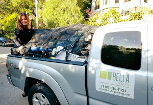 Photo of Bella helping a client haul away years of clutter